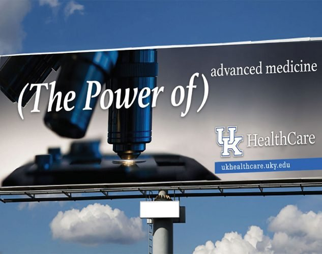 An outdoor billboard displaying a UK Healthcare advertisement.